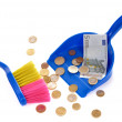 Brush sweeping euro coins and banknote isolated — Stock Photo