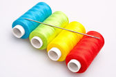 Colored thread for sewing with needle — Stock Photo