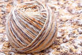 Striped beige tangle of yarn — Stock Photo