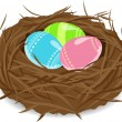 Stock Vector: Easter eggs in nest