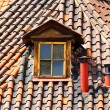 Old tiles roof and window — Stock Photo