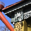 Fragment Of A Old House With Decorative Carvings And Rain Gutter - Stock Photo