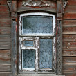 Window of very old wooden house — Stock Photo #4790468