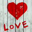 Stock Photo: Heart on wooden wall