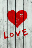 Heart on wooden wall — Stock Photo
