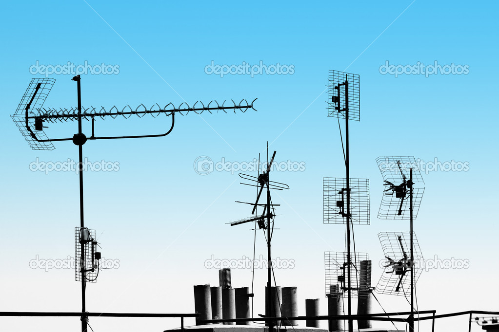 Television antennas and pipes on the rooftop  Stock Photo #5278718