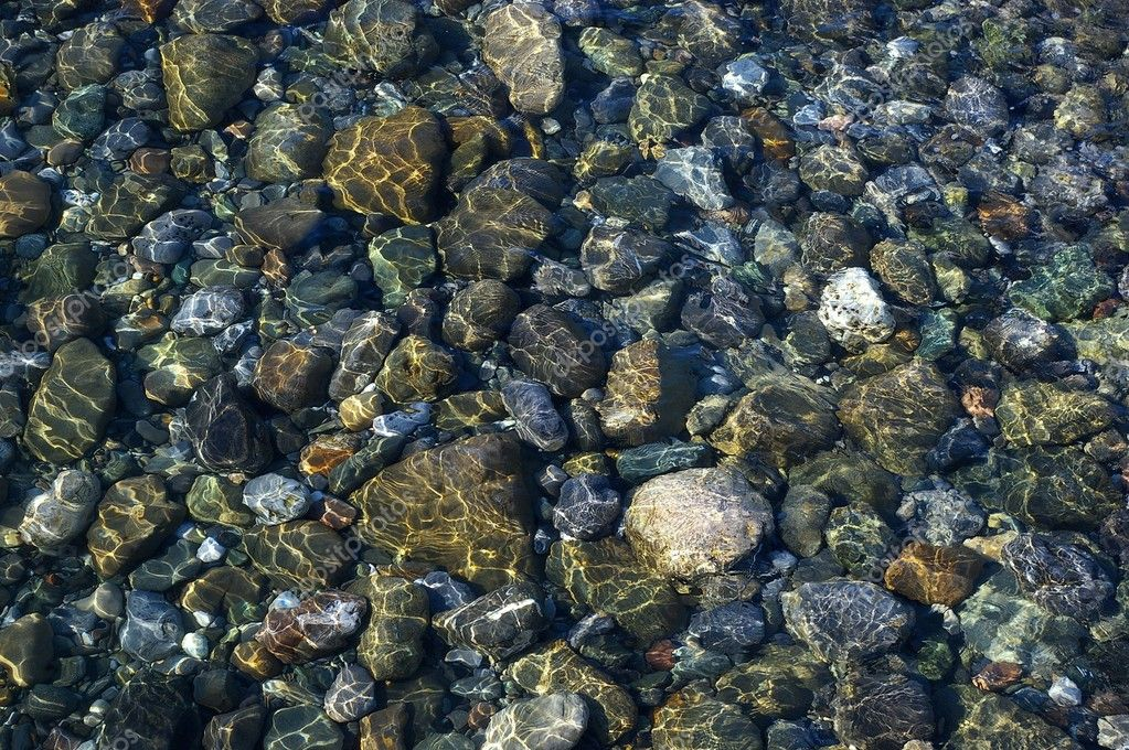 Multicolored  pebbles under the fine sea water — Stock Photo #4058805