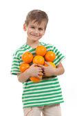 Boy holding oranges — Stock Photo