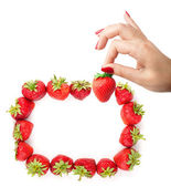 Strawberry in the hand — Stockfoto