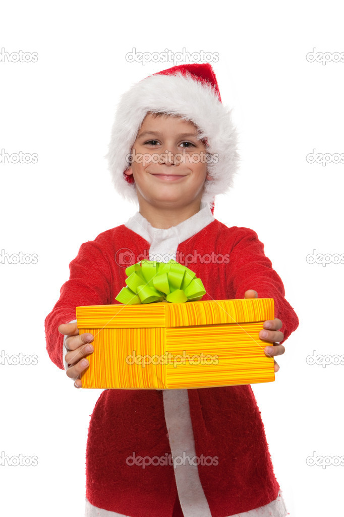 Boy holding a christmas gift isolated on white background — Stock Photo #4260103