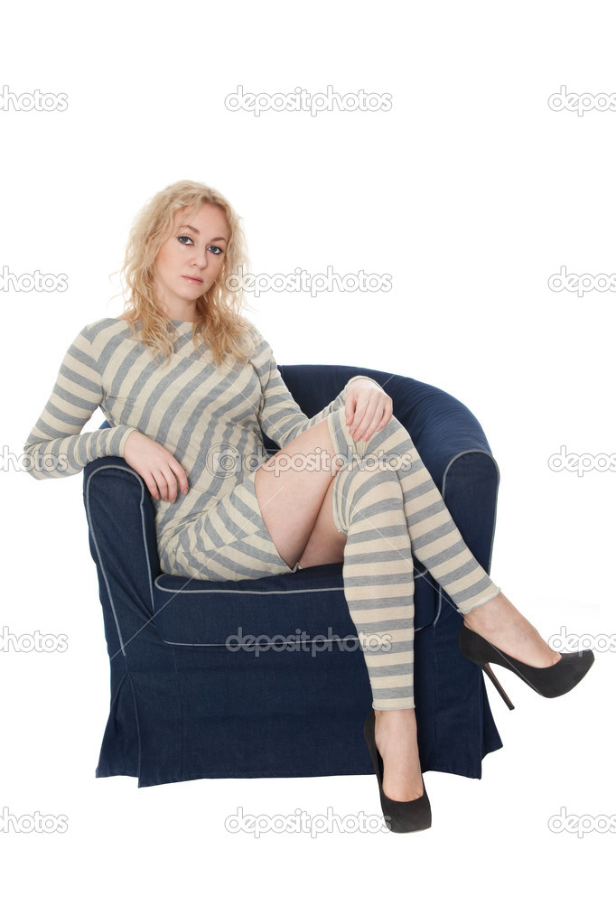 Young woman sitting in a navy armchair stock photo for Sitting in armchair