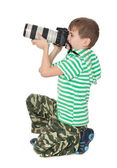 Boy holding a camera — Stock Photo