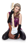 Lovely girl with electric guitar — Stock Photo