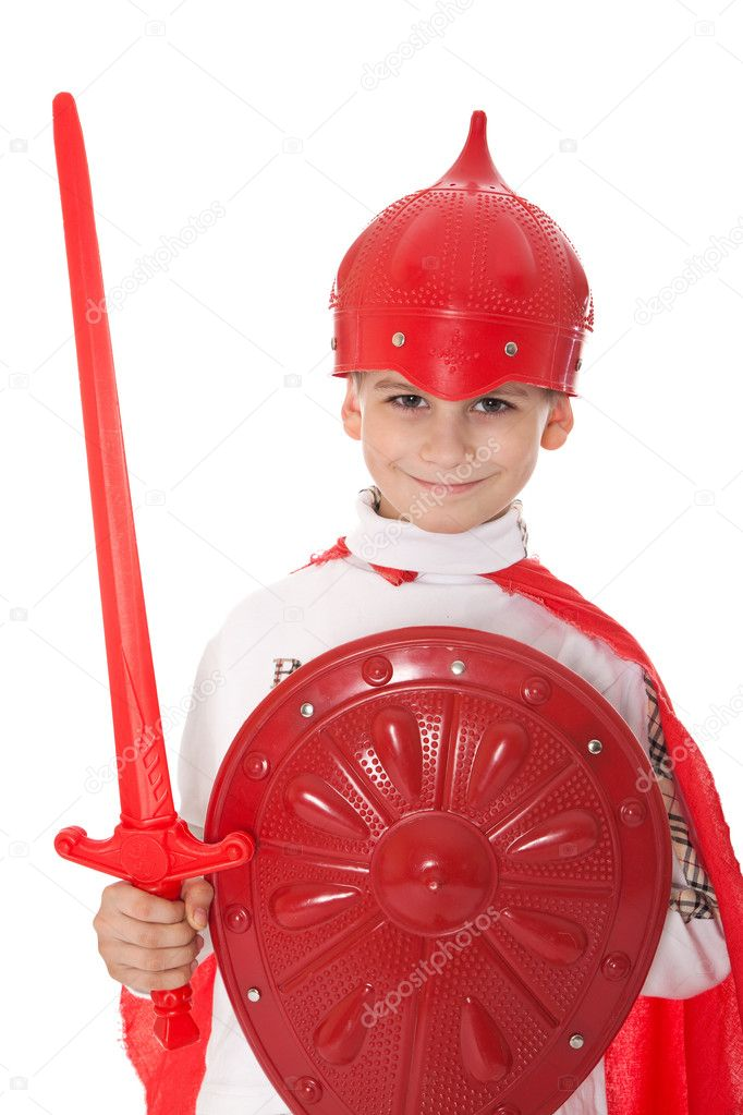 Young Boy Dressed Like a knight holding a sword and shield isolated on white — Stock Photo #5282562