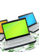 Open laptop with money — Stock Photo