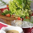 Green salad with meat and sause — Stock Photo