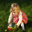Cute little girl playing with a ball — Stock Photo