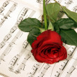 Stock Photo: Rose over musical note
