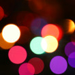 Stock Photo: Defocused light effects holiday background.