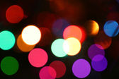 Defocused light effects holiday background. — Stock Photo