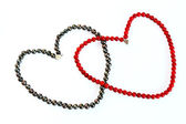 Necklace of black pearl and coral as heart — Stock Photo