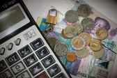 Calculator and coins as background — Stock Photo