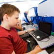 Boy flies in the plane - Stock Photo