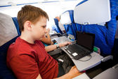 Boy flies in the plane — Stock Photo