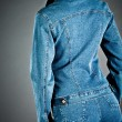 Girl in a jeans jacket - Stock Photo