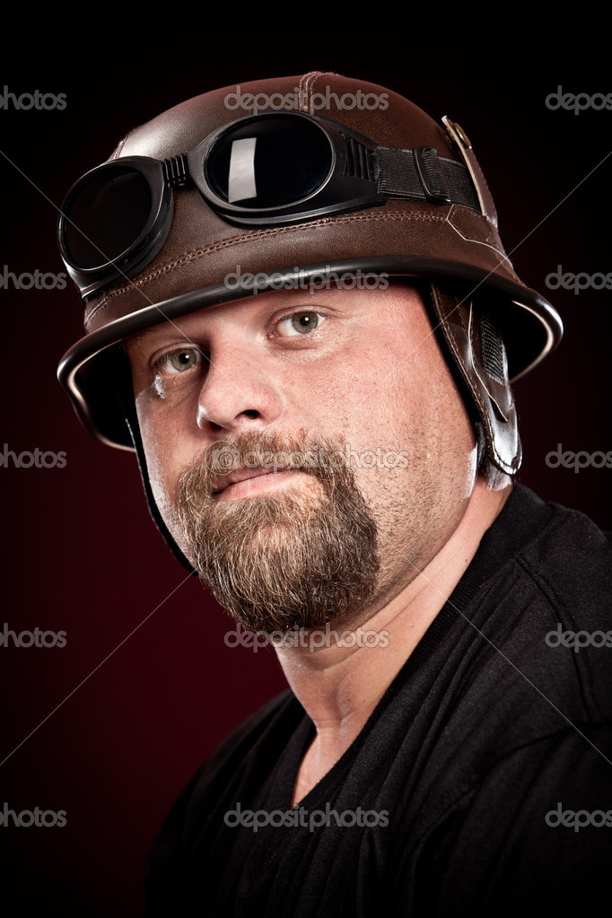 Biker in a helmet on a dark background  Stock Photo #4241554