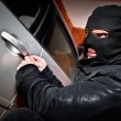 Robber and the thief in a mask hijacks the car — Stok fotoğraf