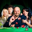Company of friends plays dice — Stock Photo