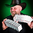 Stock Photo: Mskilfully shuffles playing cards