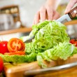 Woman's hands cutting vegetables — Stock Photo #4674770