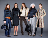 Five girls. Autumn winter collection lady's clothes — Stok fotoğraf