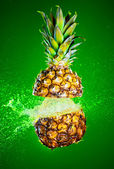 Pineapple splashed with water — Stock Photo