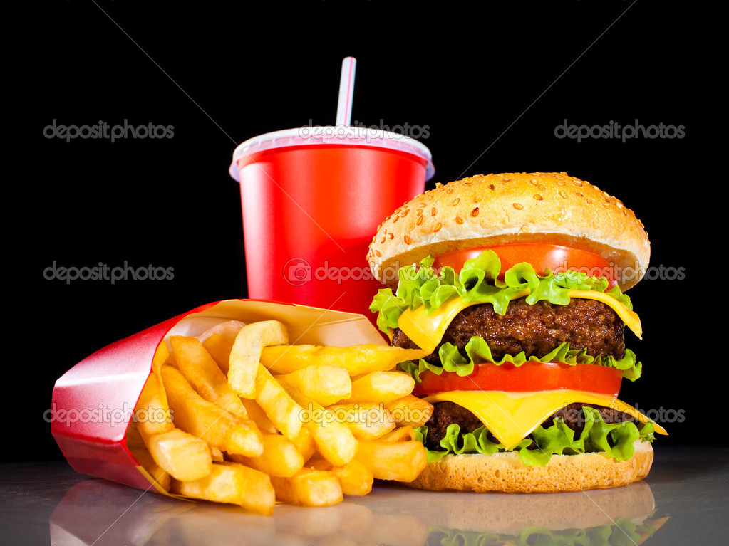 Tasty hamburger and french fries on a dark background — Stock Photo #4674733