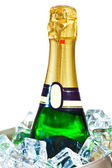 Isolated champagne bottle in ice — Stock Photo
