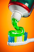 Toothpaste being squeezed onto a toothbrush — Stock Photo