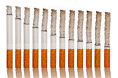 Lighted cigarettes — Stock Photo