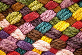 Multi colored woollen yarns — Stock Photo