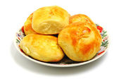 Baked buns on a plate — Stock Photo