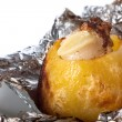 Baked potato in foil — Stock Photo