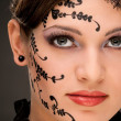 Face art of young woman — Stock Photo