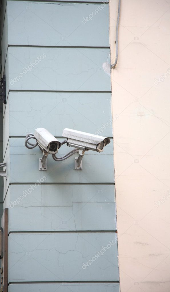 Surveillance Camera on a building wall — Stock Photo #3946740