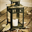 Old lantern and autumn leaves. — Stock Photo