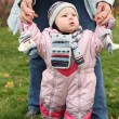 Stock Photo: Little girl in pink overalls
