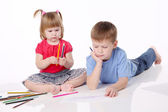 Brother and the sister draw color pencils — Stock Photo