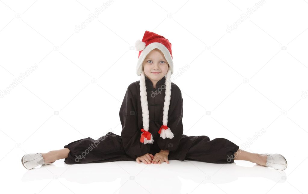 Girl-karateka in a black kimono in a Christmas cap of Santa  Stock Photo #4272416