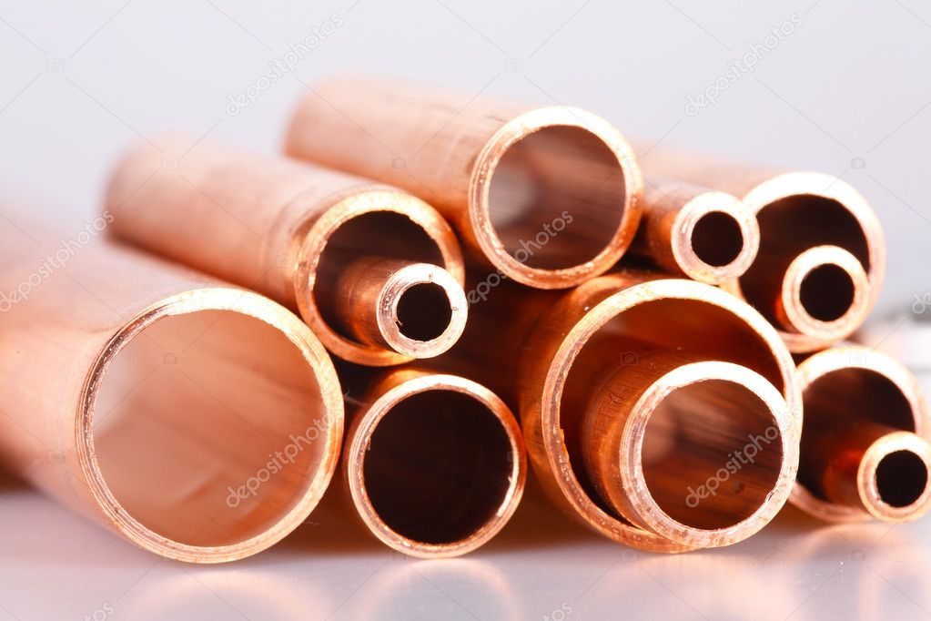 Set of copper pipes of different diameter lying in one heap — Stock Photo #4643925